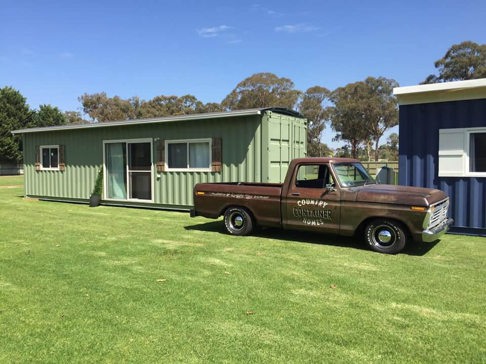Container Home on green lawn with country ute parked out the front