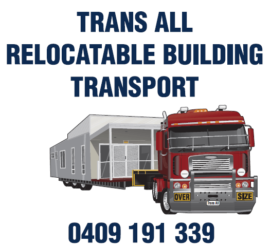 Trans All Transport truck towing a cabin