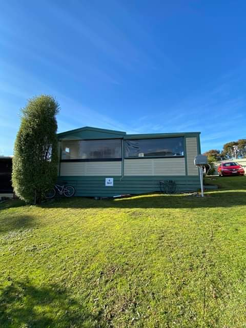 Site AN137 - Peppin Point Holiday Park large cabin with green front lawn